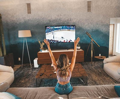 Girl watching sports on TV
