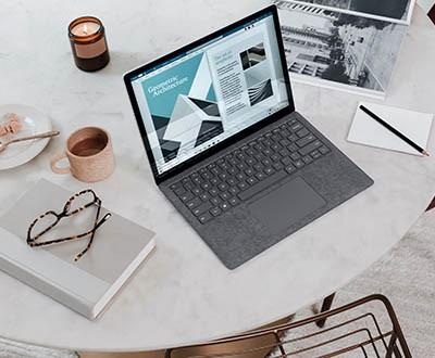 Microsoft laptop on table
